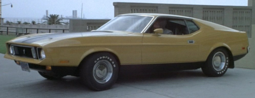 yellow Ford Mustang Mach 1