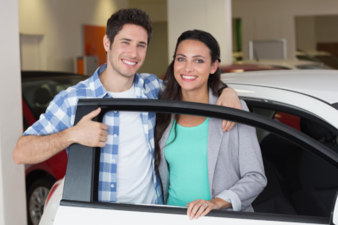 Young couple buying car: MaxAutoPro Auto Advice Blog