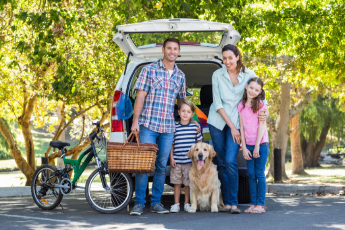 Family packing and getting reading for a road trip
