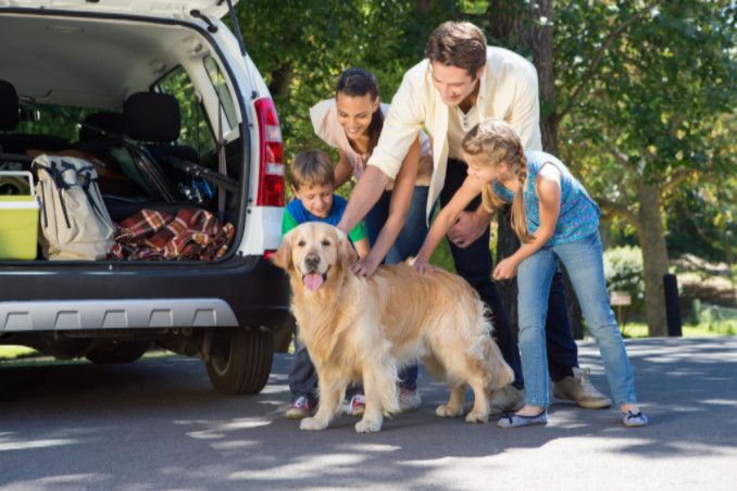 family including dog headed for vacation